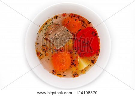 Soup: Beef broth with vegetables and meat, top view isolated on white background