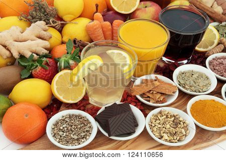 Large health food selection with drinks and herbal medicine for cold and flu remedies, high in antioxidants and vitamin c.
