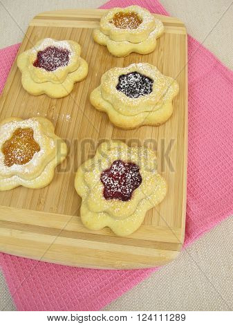 Homemade flower biscuits filled with jam for teatime