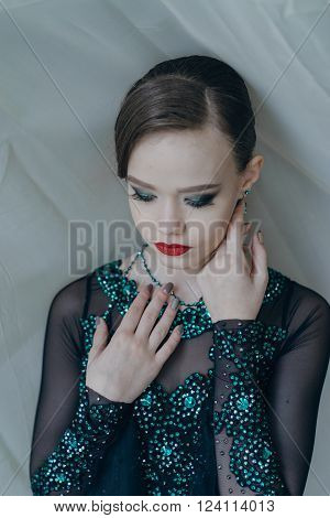 Professional dancers dancing in ballroom. Young girl