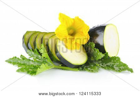 Courgette Cut Into Slices With Flower And Leaves On White