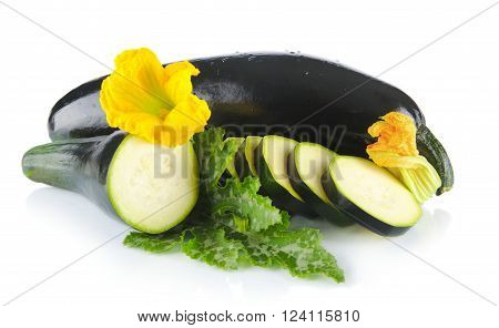 Courgettes cut into slices with flower and leaf on white
