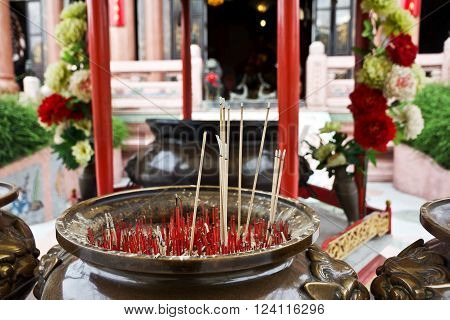 Sticks with  of smoke, burning incense in Thai-Chinese mixed temple