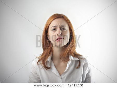 Young woman with doubtful expression