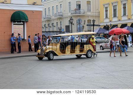 ODESSA, UKRAINE - JUNE 15, 2014: Electric vehicle serving tourist in Odessa