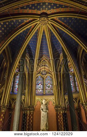 Paris, France - April 18, 2013: Statue of Louis IX in interior of Sainte-Chapelle in Paris. The Chapel was built in 1248 by King Louis IX of France to house Passion relics, including Christ's Crown of Thorns - one of the most important relics in medieval