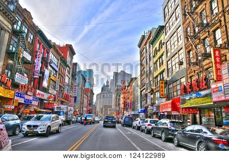 NEW YORK UNITED STATES - FEB 6 Colorful image of a typical buildings in Chinatown's main street New York. Chinatown has an estimated population of 100000 people. NYC USA Feb 6 2016