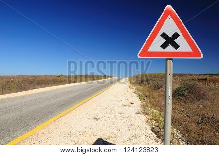 Traffic sign on Golan Heights, warning about intersection.