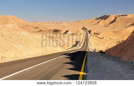Empty highway in Negev desert landscape. Israel.