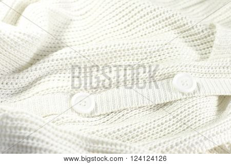 white knitted jacket with buttons. Background and texture