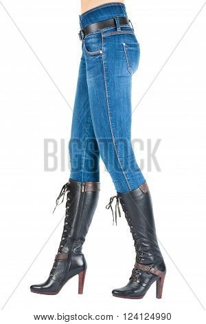 Legs In Jeans And Boots Belongs To Beautiful  Girl.