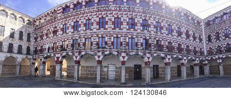 Badajoz Spain - February 27 2016: Arcades of Badajoz High Square or Plaza Alta. Panorama