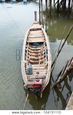 long tail boat for fishing of fisherman family