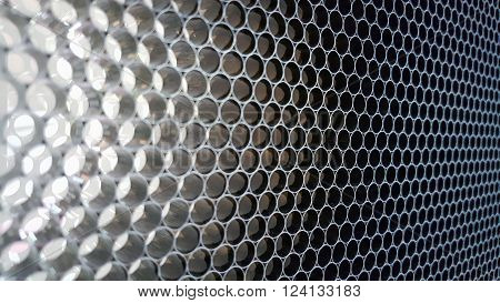 Closeup of the aluminium wire mesh material texture background.