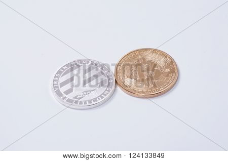Saransk, Russia - April 2, 2016: Silver-plated Litecoin and Gold-plated Bitcoin on a white background.