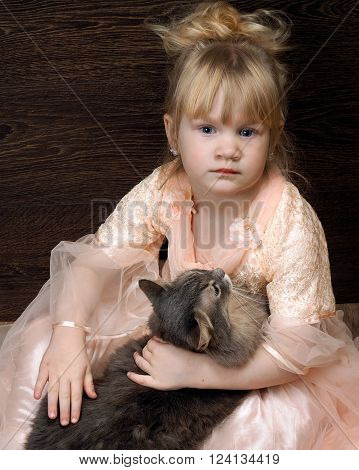 Portrait of girl with a cat. Cat large, gray. Friendship, love a young child and a cat