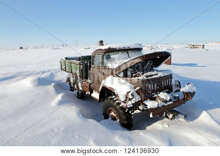 VIZE ISLAND, RUSSIA ?? APRIL 14, 2015: Abandoned truck in winter Arctic