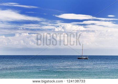 blue Mediterranean sea sky and clouds in a summer day in Apulia Southern Italy