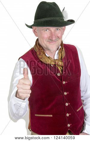 bavarian man in traditional clothes pointing thumb up