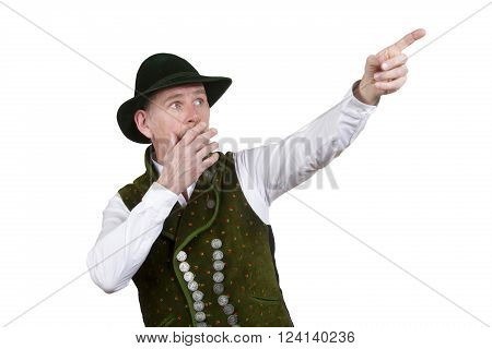 portrait of surprised bavarian man wearing traditional bavarian clothes pointing at something