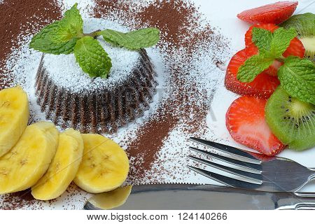 Delicious Chocolate Lava dessert with fruits on white plate