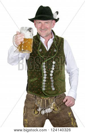 bavarian man in traditional bavarian clothes holding a mug of beer
