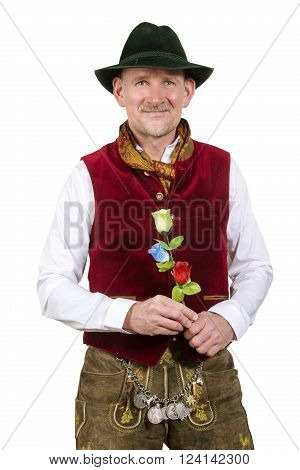 isolated portrait of bavarian man in traditional clothes holding a plastic flower
