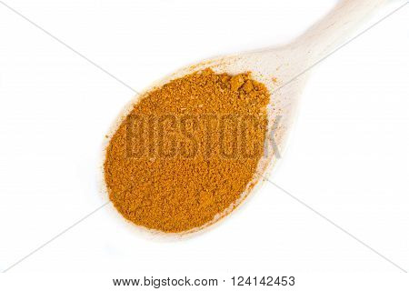 curry on a spoon on white background