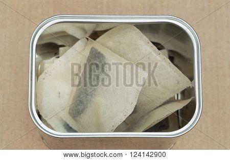some tea bags in a tin box