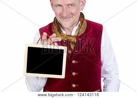 portrait of bavarian man wearing traditional bavarian clothes holding a small blackboard