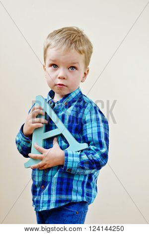 Toddler Boy With Letter