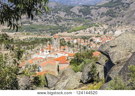 background landscape view of Monsanto village with red tile roofs and the town hall in the rocks, Portugal ** Note: Soft Focus at 100%, best at smaller sizes