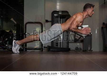 Bodybuilder Doing Extreme Push Ups On Floor