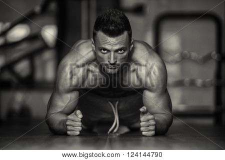 Young Man Doing Push Ups On Floor