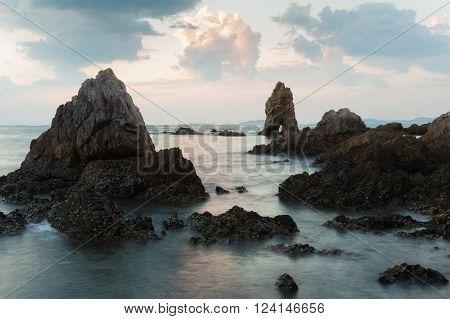 Breaking ocean rock over the sea, natural landscape background