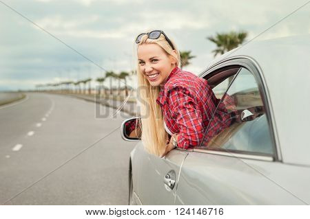Young woman auto traveler on the highway