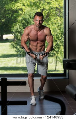 Muscular Man Working Out Chest On Cable Machine