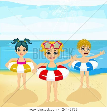 children with inflatable rings standing on the beach greeting