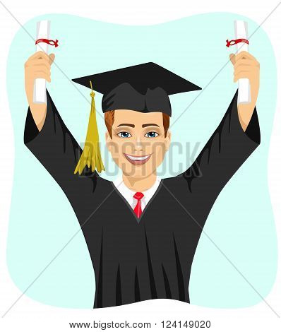 young male student holding two diplomas with both hands on graduation day isolated on white background