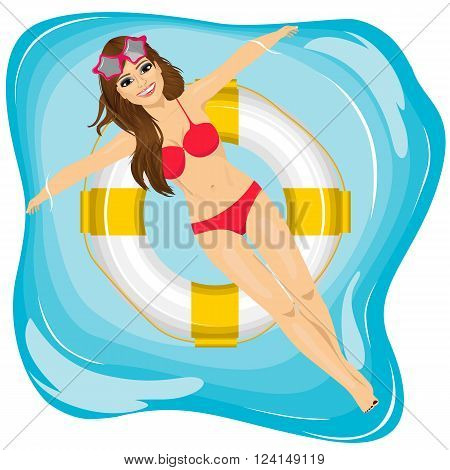 top view of attractive young girl relaxing in swimming pool  floating on an inflatable ring