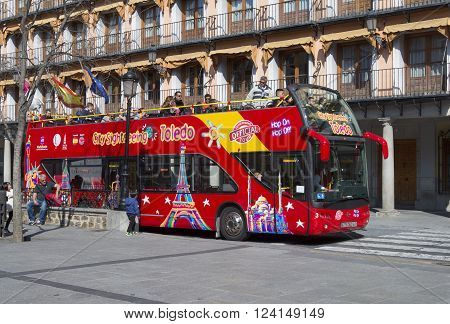 TOLEDO SPAIN - MARCH 23 2016: Touristic bus in Toledo Spain. Toledo City Tour is a touristic bus service that shows the city with an audio guide.