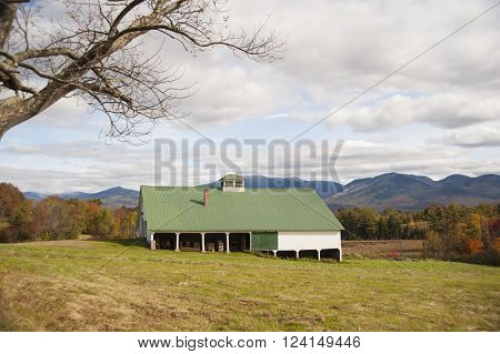 NEW HAMPSHIRE/USA - SEPTEMBER 30 2009: Barn in New Hampshire foothills as fall begins