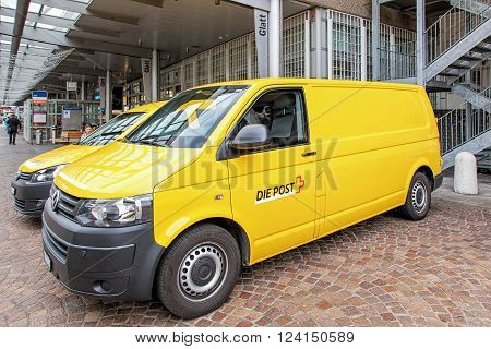 Wallisellen, Switzerland - 13 November, 2015: Swiss Post vans parked at the Glatt shopping center. Swiss Post provides the postal services in Switzerland, it is a public company owned by the Swiss Confederation.