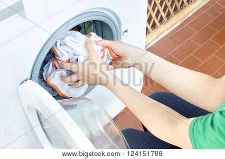 woman clothes washing machine chores empty porthole