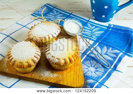 Small confiture pie and custer sugar in sieve for a baking