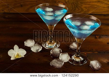 Blue cocktail in a martini glasses. Blue cocktail. Blue Martini. Blue Hawaiian cocktail. Blue curacao liqueur. Blue margarita