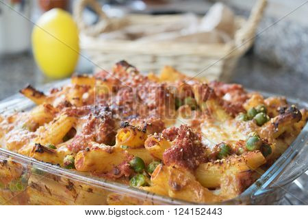meaty baked rigatoni with peas bolognese ragout mozzarella and cheese ** Note: Shallow depth of field