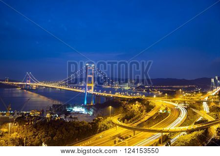 TSING MA BRIDGE, HONG KONG - MAR 18: Evening view of Tsing Ma Bridge at Tsing Yi, Hong Kong on Mar 18, 2014. It is the largest suspension bridge that has two decks to carry road and rail traffic.