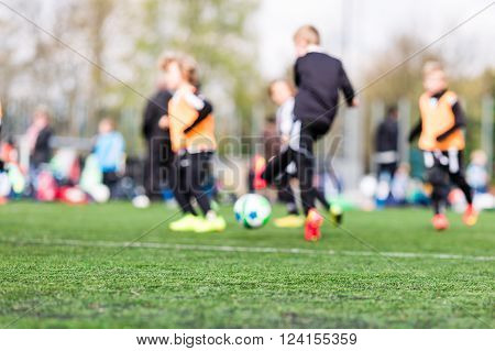 Blur Of Young Boys Playing Soccer Match