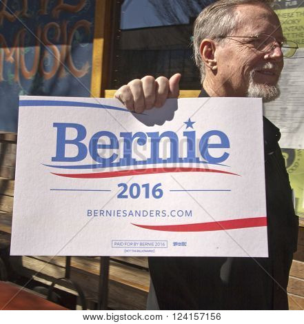 Asheville, North Carolina, USA - February 28, 2016: Close up of a Bernie Sanders campaign sign held by a campaign supporter in downtown Asheville NC